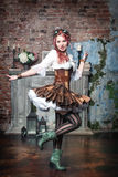 Beautiful steampunk woman spinning Stock Image