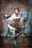 Beautiful steampunk woman spinning. Beautiful steampunk woman with pink hair spinning Stock Image