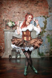 Beautiful steampunk woman spinning Stock Photography