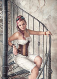 Beautiful steampunk woman on the stairway Royalty Free Stock Photos