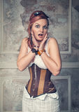 Beautiful steampunk woman surprised stock photography