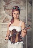 Beautiful steampunk woman with whip Stock Image