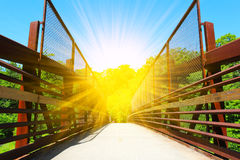 Beautiful steel bridge for bikers and walking in a wild park Royalty Free Stock Image
