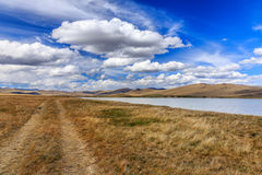 Beautiful steppe mountain landscape with river and clouds. Altai Stock Photography