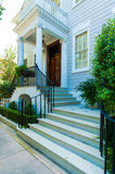 Beautiful steps leading to portico with ionic pillars Stock Image