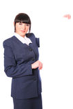 Beautiful stewardess with a blank Royalty Free Stock Photo