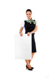 Beautiful stewardess holding blank sheet Royalty Free Stock Image