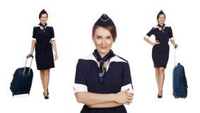 Beautiful stewardess holding suitcase isolated on white backgrou Royalty Free Stock Photo