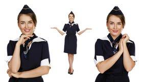 Beautiful stewardess holding suitcase isolated on white backgrou Royalty Free Stock Photos