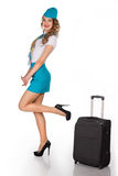 Beautiful stewardess holds baggage Royalty Free Stock Photos