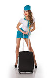 Beautiful stewardess holds baggage Royalty Free Stock Image