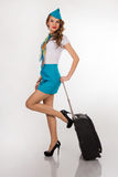 Beautiful stewardess holds baggage Stock Image