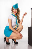 Beautiful stewardess holds baggage Stock Photo