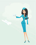 Beautiful stewardess with ticket Stock Photo