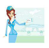 Beautiful stewardess with ticket Stock Image
