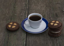 Beautiful still life of coffee and cookies on an old table Royalty Free Stock Photography