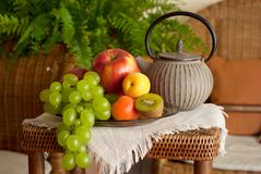 Beautiful still life image of fruits and teapot in Royalty Free Stock Images