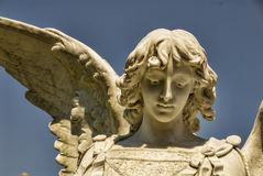 Beautiful Stone Angel Face. The head of a beautiful male stone angel statue Royalty Free Stock Photography