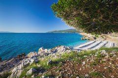 Beautiful stone beach with crystal clear tourquise sea surrounding by pine tree in Croatia, Istria, Europe Stock Photo