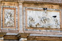 Beautiful stone carvings & decorations adorning a wall of St. Mark`s Basilica in Venice. St. Mark`s Basilica`s exterior stone carvings on the piazza san Marco in Stock Photography