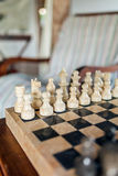 Beautiful stone chess board close-up. In cozy living room Royalty Free Stock Photography