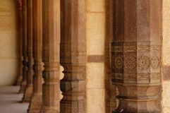 Beautiful stone columns in Amber Fort. India Stock Photo