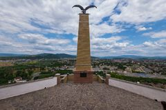 Beautiful stone monument of the eagle spreading its wings widely for flight against the background of the city royalty free stock photos