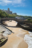 Beautiful stone walking footbridge over sandy beach in touristic destination surf spot with turquoise ocean and waves in biarritz Stock Photography