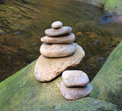 Beautiful stones. Macro photo of stone stock on bolder surrounded by river Stock Photography