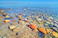 Beautiful stones in the ocean water. Baltic Sea Stock Images