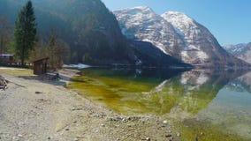 Beautiful stony lakeside in Austrian Alps, mountain lake, low season at resort. Stock footage stock video