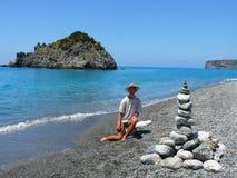 Land-art on Calabrian beach. Beautiful stony land art on Calabrian black pebble beach near Dino island royalty free stock photos