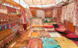 Beautiful store with old carpets, textile and colorful bedspreads on asian market Stock Photography