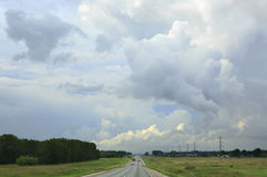 Beautiful storm clouds over the highway. Royalty Free Stock Photo