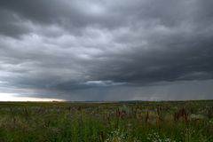 Beautiful storm sky with clouds and field. Apocalypse, tunder, tornado royalty free stock images