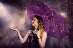 Beautiful storm woman catching falling rain drops Royalty Free Stock Photos