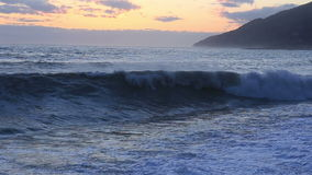 Beautiful stormy seascape at sunset time. With mountain on background stock video