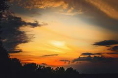Beautiful stormy sunset sky. Cloudy abstract background. Sunset colors royalty free stock photos