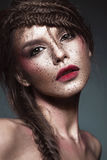 Beautiful strange girl with creative art make-up. Beauty face. Royalty Free Stock Photo
