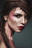 Beautiful strange girl with creative art make-up. Beauty face. Royalty Free Stock Image
