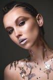 Beautiful strange girl with creative art make-up. Beauty face Royalty Free Stock Image