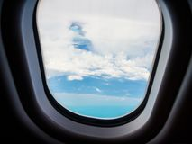 Beautiful Stratocumulus clouds view by looking through an airplane window. A Beautiful Stratocumulus clouds view by looking through an airplane window stock photography