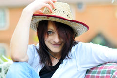 Beautiful Straw Hat Woman. Closeup of a young woman in a straw hat, black & white top and blue jeans in the sunshine Royalty Free Stock Images
