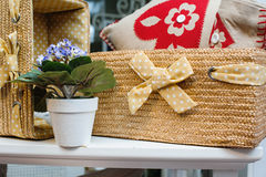 Beautiful straw laundry basket and flower room Royalty Free Stock Photos