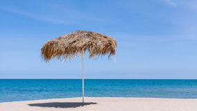 The beautiful straw umbrella at the beach. Royalty Free Stock Photo