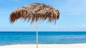 The beautiful straw umbrella at the beach. Royalty Free Stock Photo