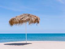 The beautiful straw umbrella at the beach. Stock Image