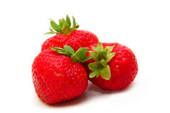 Beautiful strawberries isolated on white. Three beautiful ripe strawberries isolated on white Stock Photo