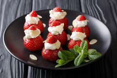 Beautiful strawberry dessert with almonds and whipped cream on a Stock Photos