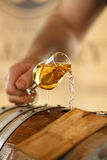 Beautiful stream into a glass of whiskey Royalty Free Stock Image
